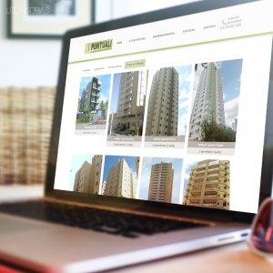 criação de site institucional - mockup Macbook - Construtora Puntuali