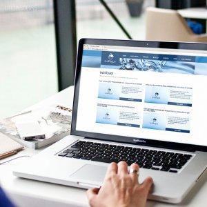criação de site institucional - mockup Macbook - Qualliagua