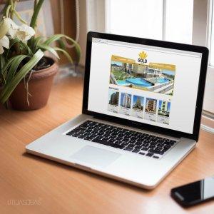 criação de site institucional para imobiliária - mockup Macbook - Gold Imóveis
